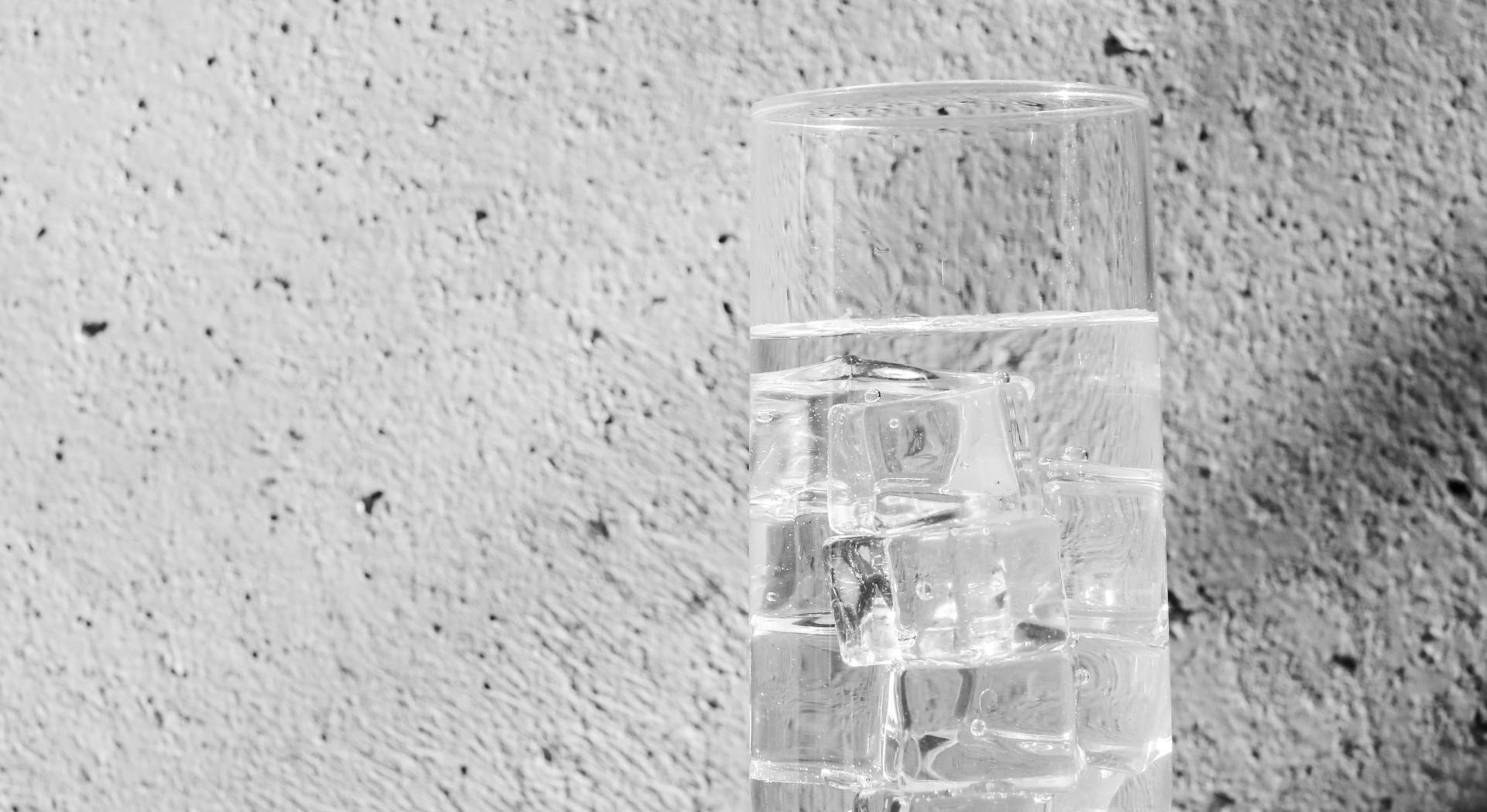 grayscale photo of a glass of water