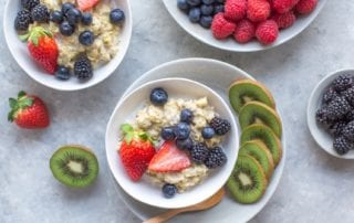 oatmeal with fruit and berries in bowls