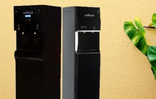 two water coolers standing side by side