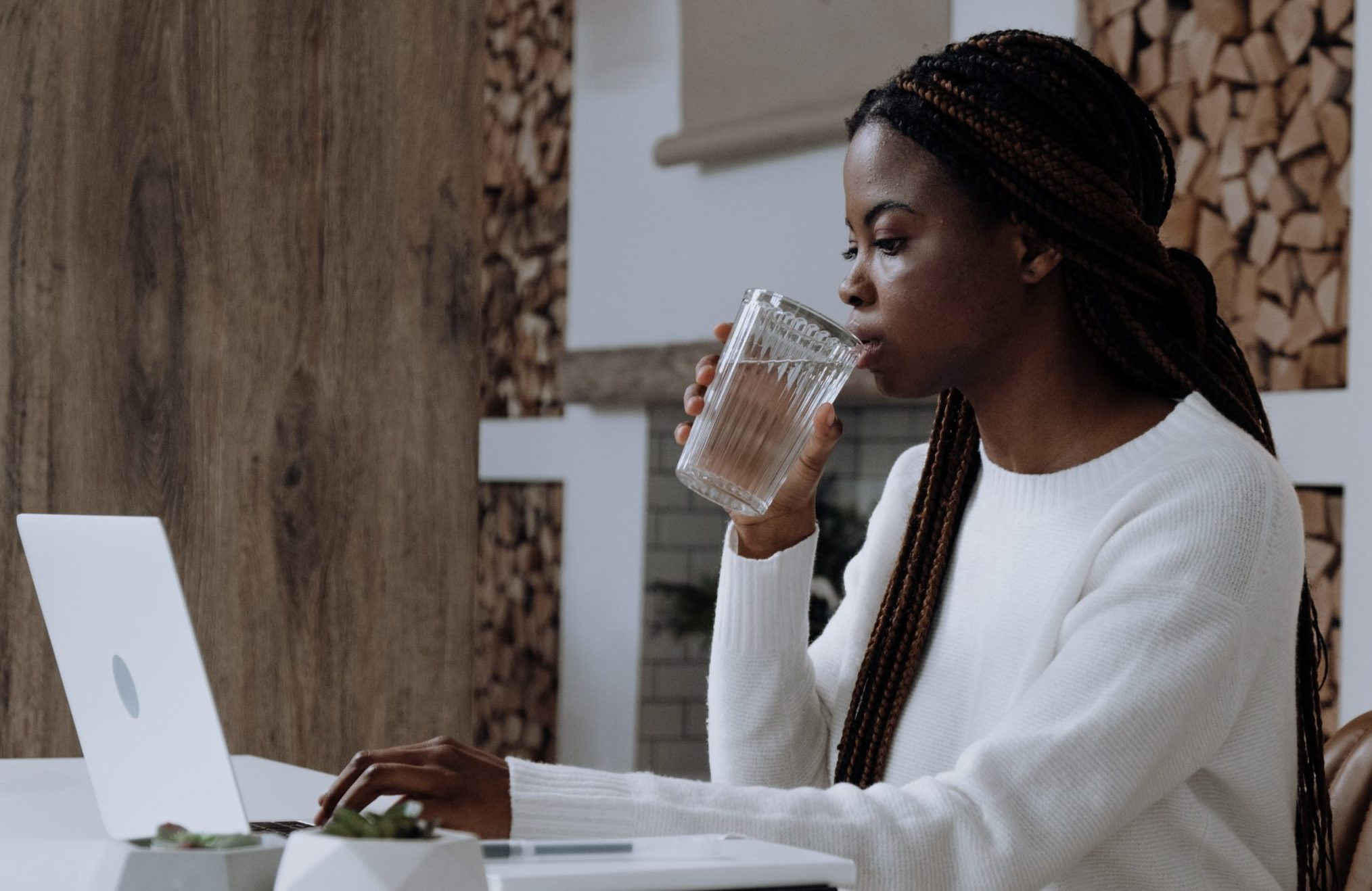 woman drinking water in the office