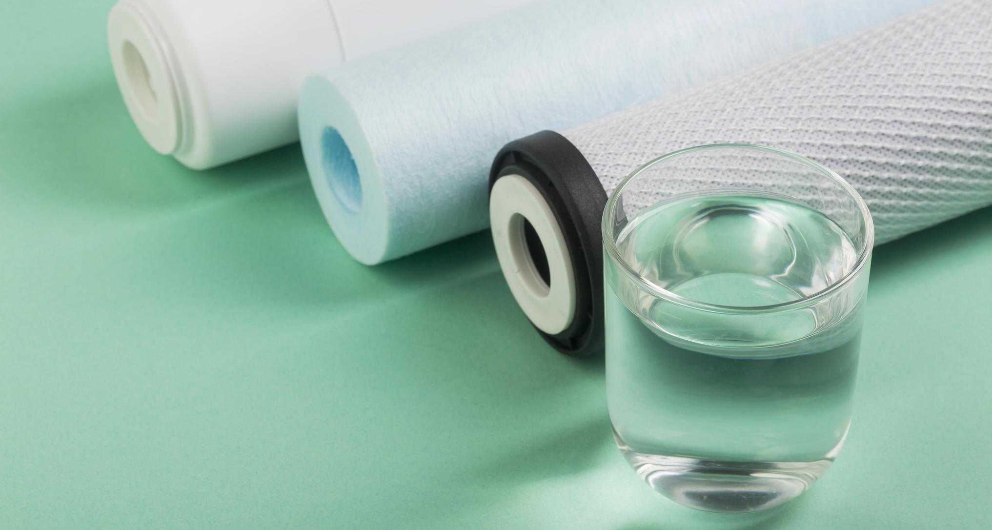 glass of water next to water filters