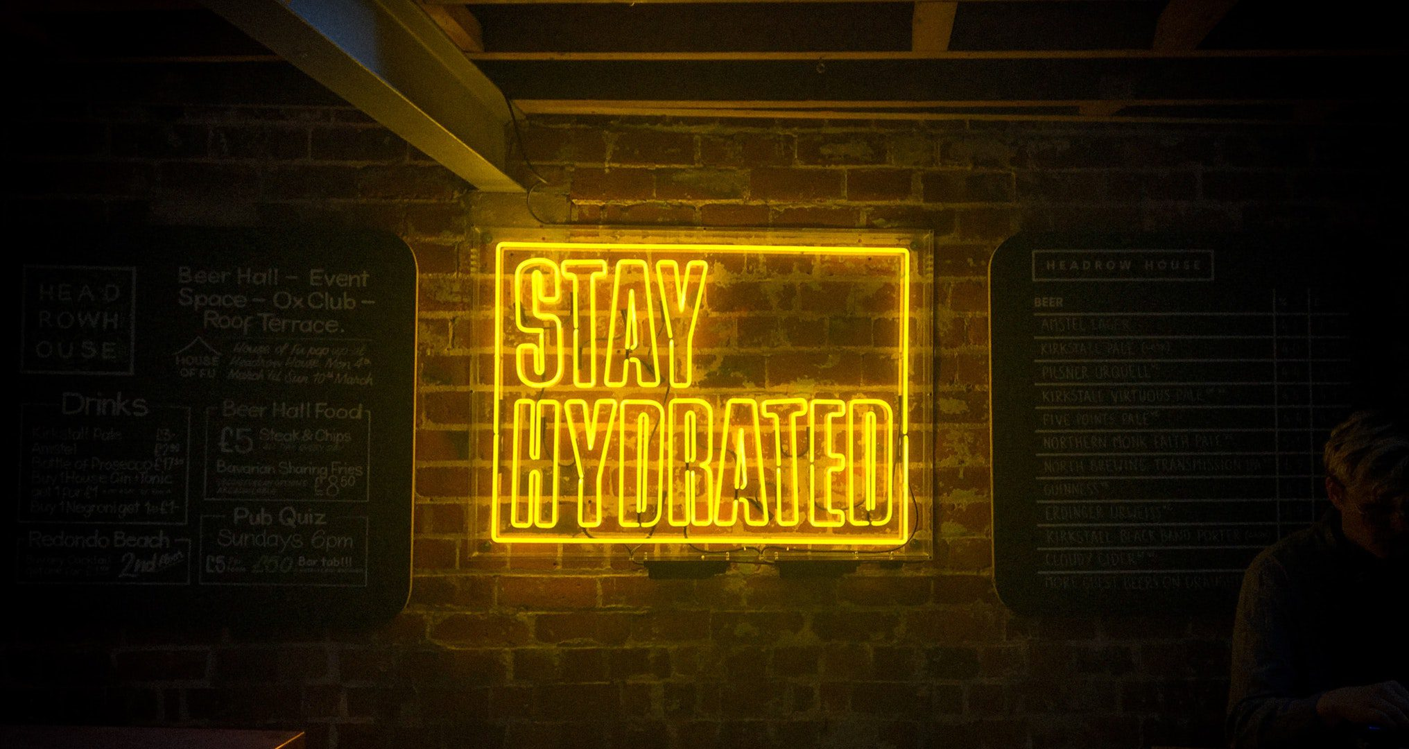 neon yellow stay hydrated sign